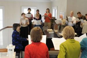 Adults singing in choir loft
