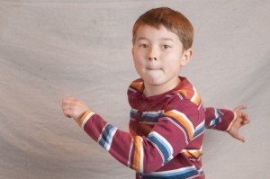 Boy running in front of the camera
