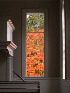 View from inside church to front yard with fall leaf colors